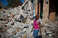 A woman passes destruction in Port-au-Prince. The 7.0 earthquake that devastated parts of Haiti on January 12 killed hundreds of thousands of people. January's earthquake killed hundreds of thousands of people and caused significant and lasting structural and economic damage in the Caribbean nation.