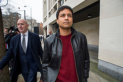 "© Licensed to London News Pictures. 23/03/2016. London, UK.""Flash crash"" Trader NAVINDER SINGH SARAO (right) leaves Westminster Magistrates court in London where a Judge has ruled that he should be extradited to the USA. Sarao, nicknamed the Hound of Hounslow, is accused of contributing to the 2010 flash crash. He has been charged with 22 counts of fraud and market manipulation by the US authorities who want to extradite him. Photo credit: Ben Cawthra/LNP"