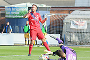 Cambridge United goalkeeper Sam Beasant  saves from York City defender John McCoombe during the Sky Bet League 2 match between York City and Cambridge United at Bootham Crescent, York, England on 3 October 2015. Photo by Simon Davies.