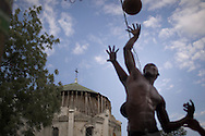 Port-au-Prince, HAITI, 20/03/2011: One year after the massive earthquake hit Haiti's capital, people try to recover their quotidian life, in the middle of a destructed city. Street basketball game beside ruins of a church.  (photo: Caio Guatelli)