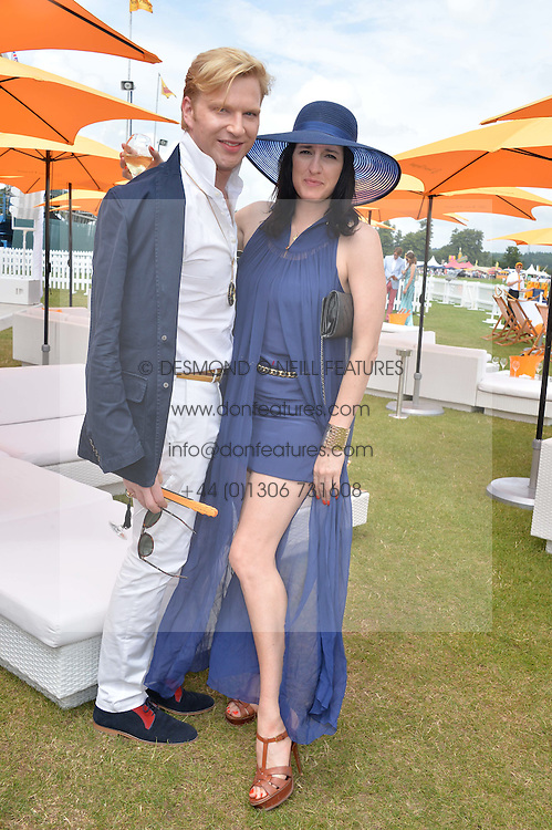 HENRY CONWAY and AMY MOLYNEAUX at the Veuve Clicquot Gold Cup Final at Cowdray Park Polo Club, Midhurst, West Sussex on 20th July 2014.