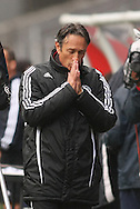 Ajax Cape Town Coach Muhsin Ertugral prays for a goal during the PSL match between Ajax Cape Town and Bidvest Wits held at Newlands Stadium in Cape Town on 13 September2009 ..Photo by Shaun Roy/www.sportzpics.net.+27 21 785 6814..