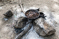 Preparing a meal over a wood fire in a temporary base , Zakouma National Park, Chad