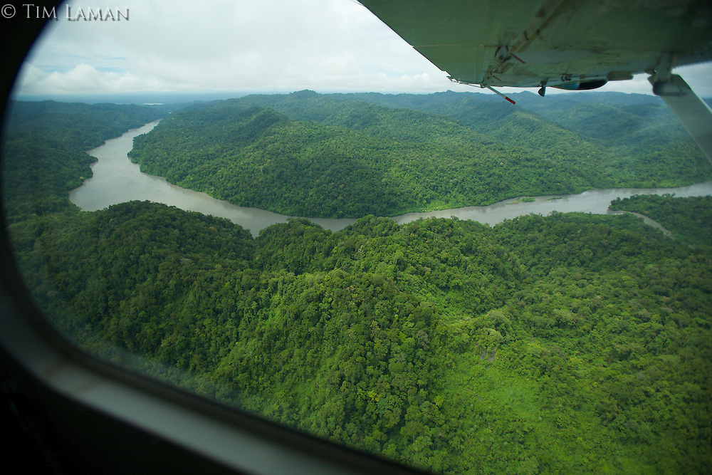 Looking out the window of a plane at the lowland rain forest along the Mamberamo River, Papua, Indonesia.  This river cuts through the foothills of the Foja Mts.