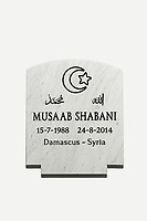 """SIRACUSA, ITALY - 8 NOVEMBER 2016: The new gravestone of Musaab Shabani, a victim of the August 24th 2014 shipwreck, is seen here after being freshly cut, engraved and painted here at the Gibilisco marble-worker's workshop in Siracusa, Italy, on November 8th 2016. It will replace the anonymous gravestone marked with the number """"9"""" in the cemetery of Sortino.<br /> <br /> Musaab Shabani was buried in the cemetery of Sortino, marked by a gravestone with the number nine because at the time he hadn't been identified yet. He was later identified by his brother Abd thanks to the efforts of policeman Angelo Milazzo. Since then, Abd has arranged to have a gravestone made bearing his brother's name and date and place of birth as well as a religious inscription in Arabic, bringing a final bit of closure to this tragic chapter. <br /> <br /> On August 24th 2014, a boat carrying more than 400 migrants, departed from the coasts of Libya in the attempt to reach Italy, capsized in international waters in the Mediterranean Sea. Rescuers of the Italian Navy saved 352 people, and recovered 24 lifeless bodies.<br /> <br /> Following the events of the Arab Spring in 2011, including Gaddafi's death and Libya's plunge towards chaos, clandestine crossings skyrocketed, as did the number of people drowning. In 2014 over 170,000 arrived in Italy and since then more than 10,000 perished in the Mediterranean sea.<br /> <br /> Only a fraction of these bodies have ever been recovered, and, of the ones that have, the majority remain unidentified. In Sicily alone there are more than 1,500 graves of anonymous refugees and migrants–people from Syria and other war torn countries–who have drowned in shipwrecks at sea.<br /> <br /> Despite the decades long persistence of the problem, Italy has yet to develop a comprehensive approach to handling the bodies of shipwreck victims. Many pieces of a functional body identification system are in place, but its overall effectiveness is crippled by a lack of coo"""