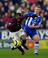 Photo: Jed Wee.<br />Wigan Athletic v Arsenal. The Barclays Premiership.<br />19/11/2005.<br />Arsenal's Thierry Henry (L) gets away from Wigan's Graham Kavanagh.
