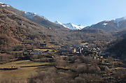 Village of Boi seen from the village of Eril la Vall, in the La Vall de Boi region near Taull, Lleida, Catalonia, Spain. This is a high mountainous area on the edge of the Pyrenees, with 9 early Romanesque churches forming a UNESCO World Heritage Site as the Catalan Romanesque Churches of the Vall de Boi. Picture by Manuel Cohen