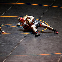 Grants Pirate Spencer Steffonsen pins Gallup Bengal Rico Browning to the mat Wednesday at Gallup High School.