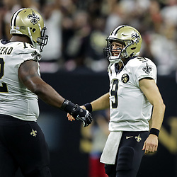 Oct 8, 2018; New Orleans, LA, USA; New Orleans Saints quarterback Drew Brees (9) reacts after setting the NFL record for yards passing yardage on a 62 yard touchdown pass to wide receiver Tre'Quan Smith (not pictured) during the second quarter against the Washington Redskins at the Mercedes-Benz Superdome.