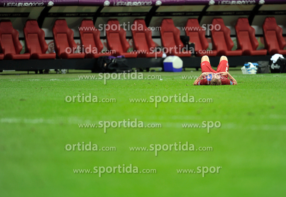 Czech's Michal Kadlec (nr03) lies on the pitch after lose match during the UEFA EURO 2012 Quarterfinal football match between Portugal and Czech Republic at National Stadium in Warsaw on June 21, 2012...Poland, Warsaw, June 21, 2012..Picture also available in RAW (NEF) or TIFF format on special request...For editorial use only. Any commercial or promotional use requires permission...Photo by © Adam Nurkiewicz / Mediasport
