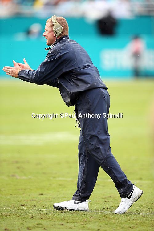 Dallas Cowboys head coach Jason Garrett claps after a key play while standing near the sideline during the 2015 week 11 regular season NFL football game against the Miami Dolphins on Sunday, Nov. 22, 2015 in Miami. The Cowboys won the game 24-14. (©Paul Anthony Spinelli)
