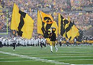 "September 3, 2011: Iowa Hawkeyes mascot ""Herky"" leads the team onto the field before the start of the game between the Tennessee Tech Golden Eagles and the Iowa Hawkeyes at Kinnick Stadium in Iowa City, Iowa on Saturday, September 3, 2011. Iowa defeated Tennessee Tech 34-7 in a game stopped at one point due to lightning and rain."