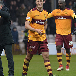 Carl McHugh (Motherwell) salutes the Motherwell fans at full time after scoring the winner in the Scottish Cup quarter final between Motherwell and Hearts at Fir Park, where the home side made it into the semi final draw with a win.<br /> <br /> (c) Dave Johnston | sportPix.org.uk