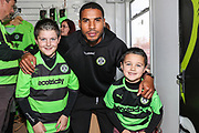 Forest Green Rovers Reuben Reid(26) helps out in the club shop during the EFL Sky Bet League 2 match between Forest Green Rovers and Cheltenham Town at the New Lawn, Forest Green, United Kingdom on 20 October 2018.