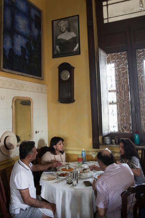 Family enjoying lunch at La Guarida, an upscale paladar (family-run restaurant) in Centro Habana, in Havana, Cuba.