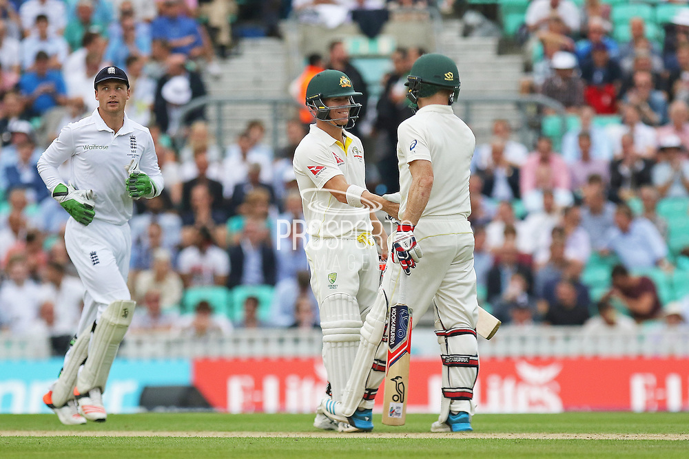 David Warner of Australia and Chris Rogers of Australia celebrate the 100 up during the 1st day of the 5th Investec Ashes Test match between England and Australia at The Oval, London, United Kingdom on 20 August 2015. Photo by Phil Duncan.