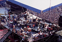 The Grateful Dead Live at Giants Stadium September 2, 1978. The Band on Stage performing. Photo taken behind the Stage.