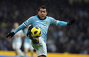 Carlos Tevez of Manchester City in action during the Barclays Premier League match between Manchester City and West Bromwich Albion at the City of Manchester Stadium on February 5, 2011 in Manchester, England.