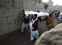 Afghans carry the body of a victim who was killed in a bomb blast in Nangarhar Province, Afghanistan, December 17, 2012, Photo by Imago / i-Images...UK ONLY