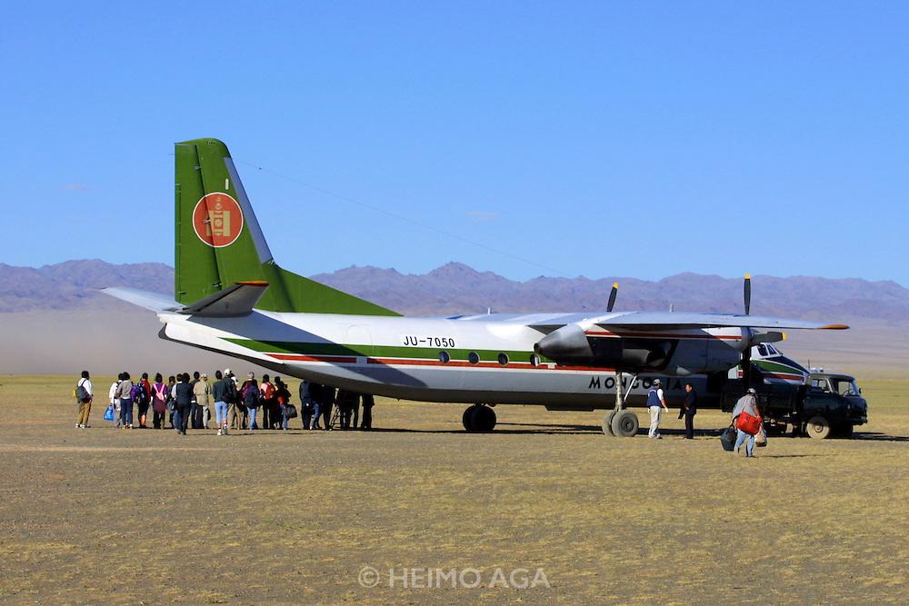 GOBI DESERT, MONGOLIA..08/23/2001.Antonov AN-24 MIAT flight Juulchin Gobi tourist camp - Ulan Bator starting from the camp..(Photo by Heimo Aga)