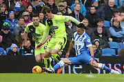 Huddersfield Town midfielder Emyr Huws (16) is tackled by Brighton central midfielder, Beram Kayal (7) during the Sky Bet Championship match between Brighton and Hove Albion and Huddersfield Town at the American Express Community Stadium, Brighton and Hove, England on 23 January 2016. Photo by Geoff Penn.