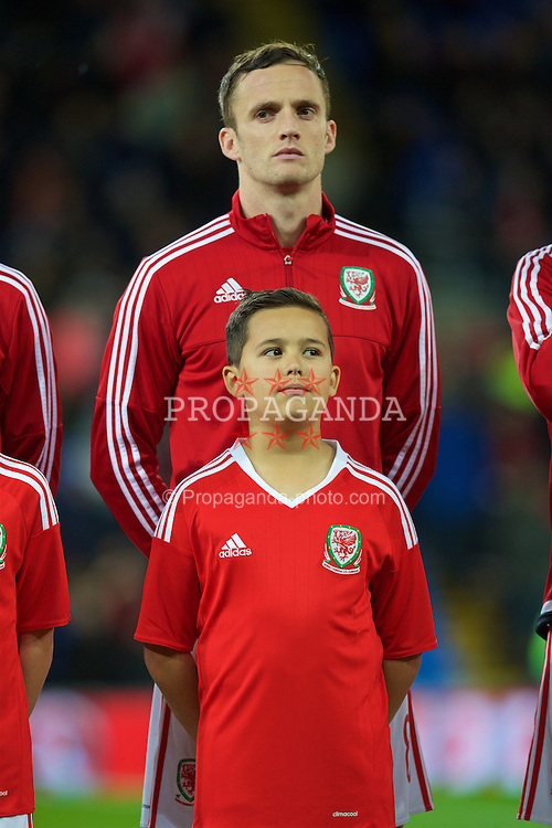 CARDIFF, WALES - Friday, November 13, 2015: A player mascot with Andy King before the International Friendly match against the Netherlands at the Cardiff City Stadium. (Pic by David Rawcliffe/Propaganda)