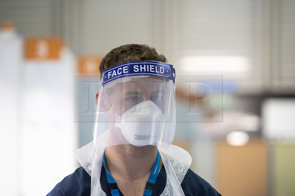 © Licensed to London News Pictures . 15/04/2020. Manchester, UK. Clinicians wearing PPE whilst working in the Nightingale NW Hospital . The National Health Service has built a 648 bed field hospital for the treatment of Covid-19 patients , at the historical railway station terminus which now forms the main hall of the Manchester Central Convention Centre . The facility is due to fully open this week (ending Friday 17th April 2020 ) and will treat patients from across the North West of England , providing them with general medical care and oxygen therapy after discharge from Intensive Care Units . Photo credit : Joel Goodman/LNP