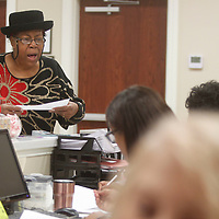 """Jennifer Jones sings to the office workers at Cook's Adult Day Care in New Albany. Jones is known by many as the """"Community Angel"""" and is a Christian missionary."""
