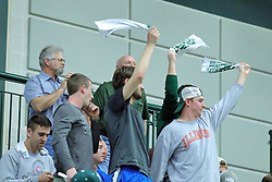 21 February 2017:  Cat Towels are waved by fans at half time to celebrate a Titan lead by a 2-1 ratio during an College men's division 3 CCIW basketball game between the Augustana Vikings and the Illinois Wesleyan Titans in Shirk Center, Bloomington IL
