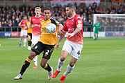 Conway of Salford City challenged by Cambridge United defender Kyle Knoyle during the EFL Sky Bet League 2 match between Salford City and Cambridge United at Moor Lane, Salford, United Kingdom on 12 October 2019.