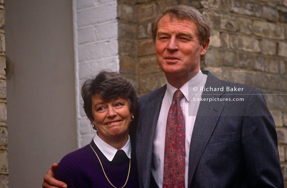 "Liberal Democrat leader Paddy Ashdown and wife Jane on the steps of their Kennington home, on 6th february 1992, in London England. Following the press becoming aware of a stolen document relating to a divorce case, he disclosed a five-month affair with his secretary, Patricia Howard, five years earlier. He and his marriage weathered the political and tabloid storm, with his wife of 30 years forgiving him. The revelation of his affair sparked the front page headline ""It's Paddy Pantsdown"" from The Sun newspaper."