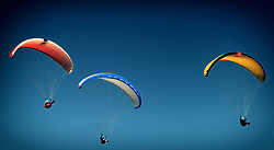 May 23, 2019 - Kozakov, Czech Republic - Paragliders at Bohemian Paradise (80 kilometers north from Prague) in Czech Republic. Paragliding is a recreational and competitive flying sport. The pilot sits in a harness suspended below a fabric wing, whose shape is formed by the pressure of air entering vents in the front of the wing. (Credit Image: © Slavek Ruta/ZUMA Wire)