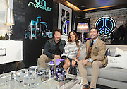 Interior designer Nate Berkus, left, actress Nikki Reed, center, and fragrance developer Carlos Huber help celebrate the launch of Unstopables, a suite of long-lasting air, home & fabric care scents, that are designed to style and elevate one's environment and wardrobe during an event at Maison 24 in New York, Thursday, Feb. 19, 2015. (Photo by Diane Bondareff/Invision for Unstopables/AP Images)