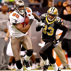 January 2, 2011; New Orleans, LA, USA; Tampa Bay Buccaneers wide receiver Maurice Stovall (85) is pursued by New Orleans Saints cornerback Jabari Greer (33) during the second quarter at the Louisiana Superdome. Mandatory Credit: Derick E. Hingle