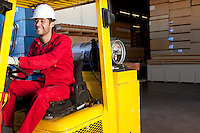 Warehouse worker using forklift truck