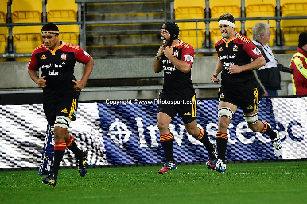 Ben Tameifuna (L), Tanerau Latimer and Sam Cane of the Chiefs run onto the field during a Super Rugby - Hurricanes v Chiefs match at the Westpac Stadium in Wellington on Saturday the 24th of May 2014. Photo by Marty Melville/www.Photosport.co.nz