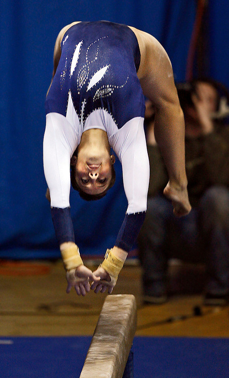 BYU's Dayna Smart performs on the beam against Boise State in women's gymnastics at the BYU Smith Fieldhouse Saturday Feb 3, 2007 in Provo, Utah. August Miller/Deseret Morning News