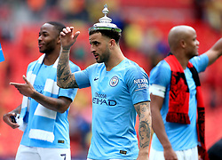 Manchester City's Kyle Walker celebrates with the FA Cup lid on his head after winning the FA Cup Final at Wembley Stadium, London.