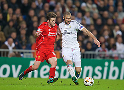 MADRID, SPAIN - Tuesday, November 4, 2014: Liverpool's Adam Lallana in action against Real Madrid's Karim Benzema during the UEFA Champions League Group B match at the Estadio Santiago Bernabeu. (Pic by David Rawcliffe/Propaganda)