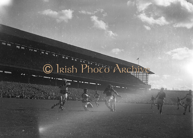 Down player kicks the ball towards the goal during the All Ireland Senior Gaelic Football Final Down v. Offaly in Croke Park on the 24th September 1961. Down 3-6 Offaly 2-8.