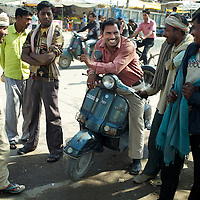 Day-wage casual laborers and agents offering employment gather at the Bara Birwa labour post in Lucknow.  Those who are lucky enough to find work can expect to earn Rs.130 to Rs.150 per day. A lack of employment opportunities and caste discrimination that denies people access to land and social secutiy measures fuels labour migration - much of it seasonal - from poor rural areas across Uttar Pradesh - and beyond - to cities like Lucknow. Many of these migrants end up undertaking poor-paying and insecure work on construction sites in cities like lucknow.  ..Photo: Tom Pietrasik.Lucknow, Uttar Pradesh. India.March 3rd 2011.