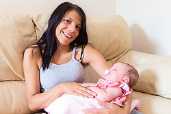 Kia with 4 month-old little Harriet Rose. Kia Neale, 20, gave birth to her baby Harriet Rose just 48 hours after discovering that she was 22 weeks pregnant. Little Harriet Rose was born 18 weeks prematurely on the steps to the bathroom of their Whitechapel flat, delivered by her partner Darren Arnold, 23. Harriet Rose is two-year-old Harper's little sister. London, August 01 2019.