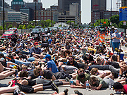 06 JUNE 2020 - DES MOINES, IOWA: Members of Black Lives Matter lay in Grand Ave. in front of the Des Moines City Hall for 8 minutes 45 seconds, the amount of time a Minneapolis police officer knelt on George Floyd's neck. More than 1,000 protesters marched through downtown Des Moines to the state capitol to demand an end to police violence against Black people. The march was organized by Black Lives Matter and honored George Floyd, the unarmed Black man killed by Minneapolis police on 25 May 2020.          PHOTO BY JACK KURTZ