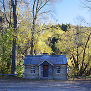 Autumn in Arrowtown. An Historic Cottage at the end of town. .Arrowtown is the much visited, historic, 4-season, southern hemisphere holiday destination, located only 20 minutes drive from Queenstown, South Island, New Zealand..Arrowtown is a former gold-mining town built on the banks of the Arrow River, once a rich source of gold in the 1860's and now a sophisticated, multi-cultural town catering visitors from around the globe. Arrowtown offers an ambiance with its shops, restaurants, cafes, offices and galleries located within a tight precinct.  5th April 2011.  Photo Tim Clayton.