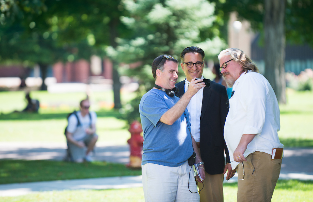 Actor Andy Garcia chats with the director and crew during the on-campus filming of their movie, 'Admissions'.