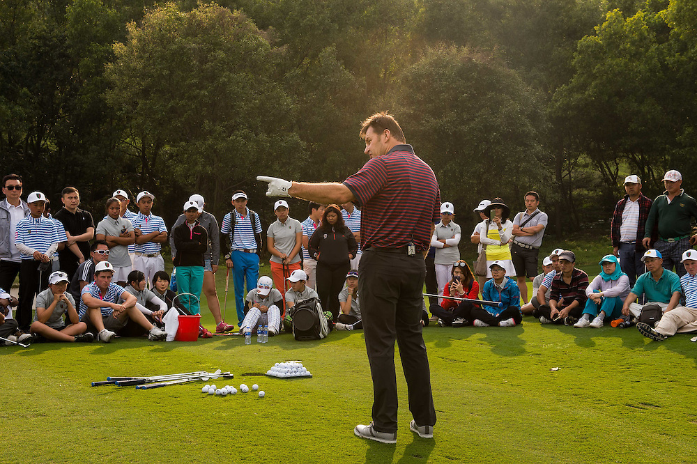 Partcipants attend the clinic by Sir Nick Faldo during day two of the 10th Faldo Series Asia Grand Final at Faldo course on 03 March of 2016 in Shenzhen, China. Photo by Xaume Olleros.