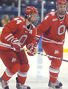 OSU's Sergio Somma (44) and linemate Corey Toy (4) head toward the team bench after scoring the first goal in the Buckeyes Friday night game against the LSSU Lakers at Taffy Abel Arena in Sault Ste. Marie.