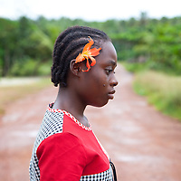 Mary, an Ivorian Refugee, wears a flower on her ear. I asked her if she knew who Billie Holiday was?  She smiled and said no...