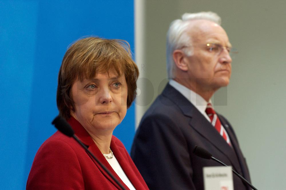 02 APR 2004, BERLIN/GERMANY:<br /> Angela Merkel (L), CDU Bundesvorsitzende, und Edmund Stoiber (R), CSU, Ministerpraesident Bayern, waehrend einem Pressestatement zu dem vorangegangenem europapolitischen Spitzengespraech von CDU und CSU, Konrad-Adenauer-Haus<br /> IMAGE: 20040402-02-011<br /> KEYWORDS: Ministerpr&auml;sident, CDU Bundesgeschaeftsstelle