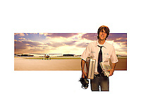 Young flight instructor with plane and sunset in background.